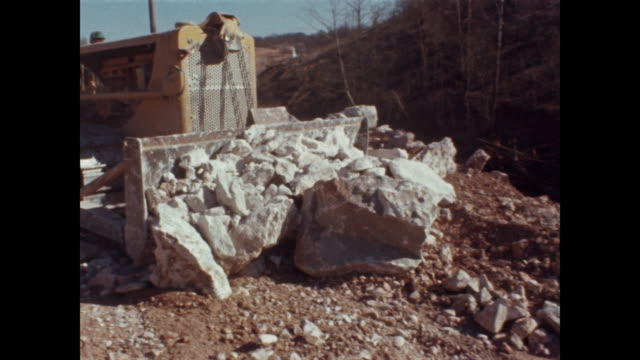 bulldozer moves pile of boulders - bulldozer stock videos & royalty-free footage