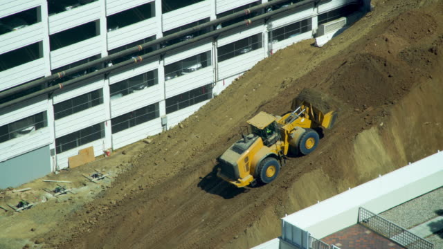 bulldozer moving dirt up a steep incline on a construction site - scooping stock videos & royalty-free footage