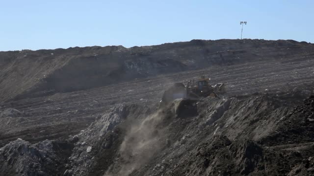 bulldozer moving mounds of earth - coal mine stock videos and b-roll footage