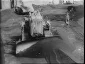 Bulldozer moving through street of solerno cleaning up ash people video id542516963?s=170x170