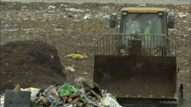 ms, bulldozer on landfill site, ardley, oxfordshire, united kingdom - oxfordshire stock videos & royalty-free footage