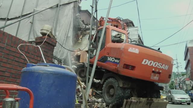 ms la bulldozer on top of rubble /ansan, south korea - rubble stock-videos und b-roll-filmmaterial