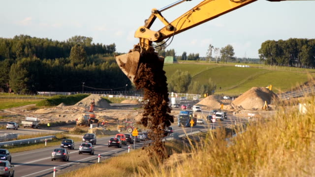 bulldozer puring sand road construction - railings stock videos & royalty-free footage