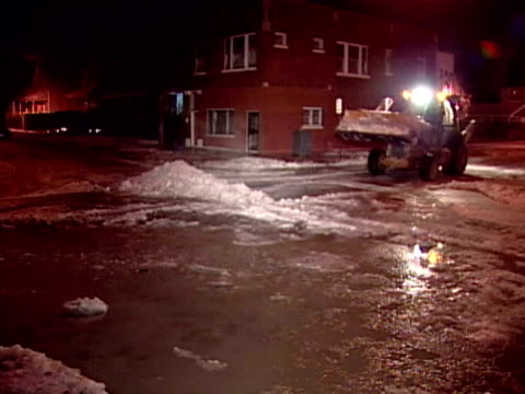 bulldozer pushes ice and slush off road at night on january 20 2004 in chicago illinois - slush stock videos and b-roll footage