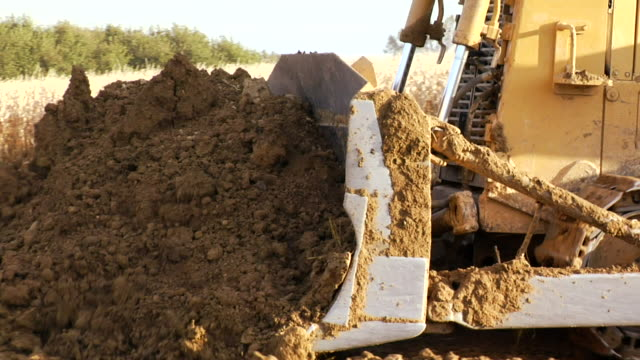 cu pan bulldozer pushing dirt next to cornfield/ kewaunee, illinois - bulldozer stock videos and b-roll footage