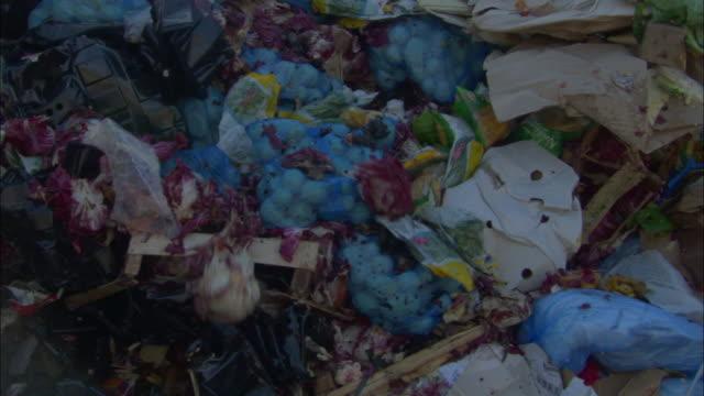 CU, Bulldozer pushing pile of garbage on landfill site, Ardley, Oxfordshire, United Kingdom