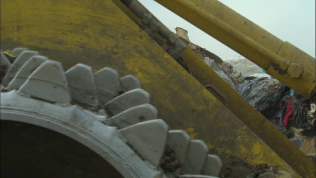 cu, bulldozer pushing pile of garbage on landfill site, ardley, oxfordshire, united kingdom - landfill stock videos & royalty-free footage
