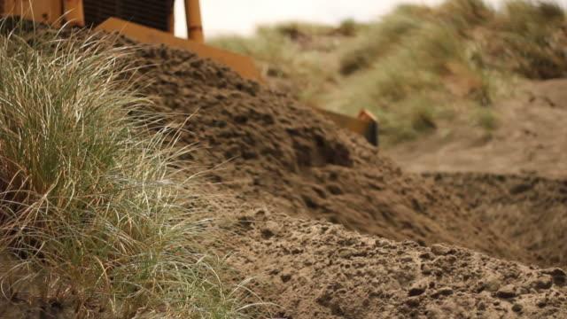 bulldozer pushing sand - bulldozer stock videos and b-roll footage