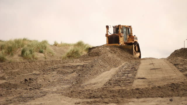 bulldozer pushing sand - bulldozer stock videos and b-roll footage