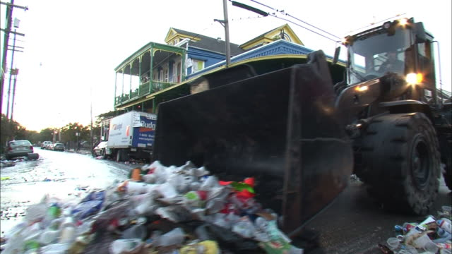 a bulldozer scoops all kinds of trash off a street in new orleans. - bulldozer stock videos & royalty-free footage