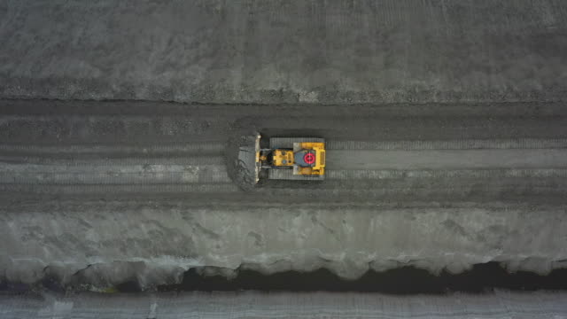 bulldozer working in a mine as seen from a top-down aerial perspective, florida, united states of america - miner stock videos & royalty-free footage