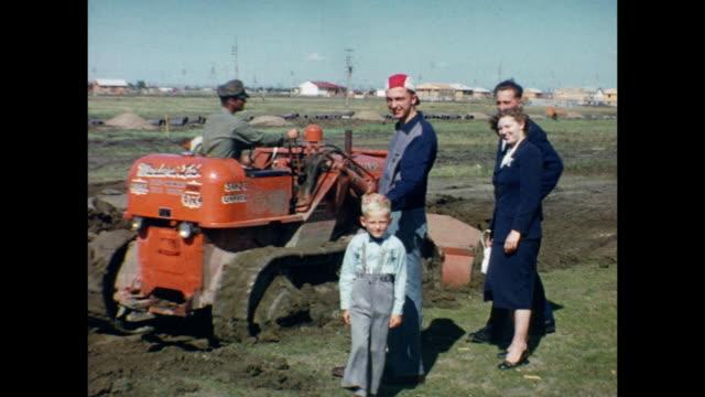1954 home movie bulldozers at work on residential construction site / regina, saskatchewan - bulldozer stock videos and b-roll footage