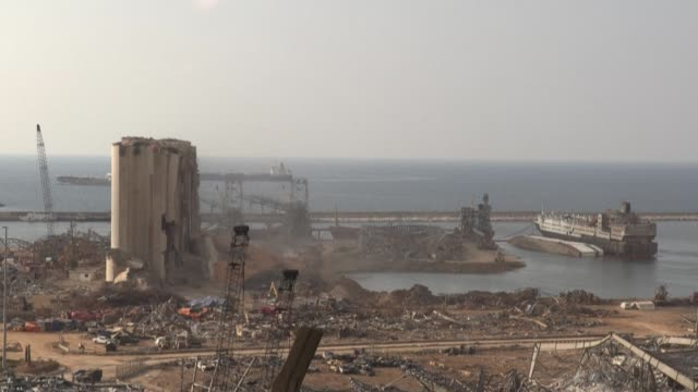 bulldozers clear rubble near the heavily damaged grain silo in beirut's port a week after a massive explosion triggered by a stock of ammonium... - {{ collectponotification.cta }} stock videos & royalty-free footage