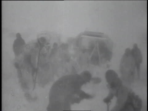 bulldozers clear snow from roads as allied soldiers shovel snow from their murdered comrades. - frozen stock videos & royalty-free footage