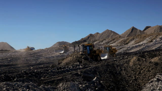 4 bulldozers moving earth at a coal mine - coal mine stock videos & royalty-free footage