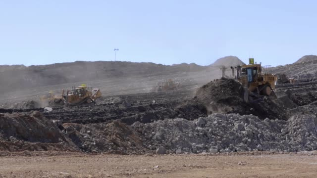 bulldozers moving mountains of dirt at a coal mine - coal mine stock videos & royalty-free footage