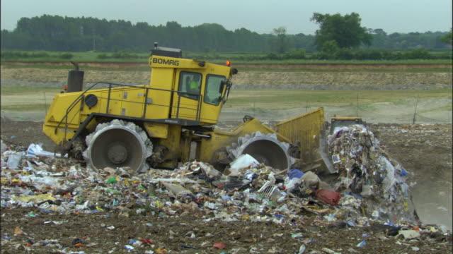 zo, ws, bulldozers on landfill site, ardley, oxfordshire, united kingdom - uk stock videos & royalty-free footage