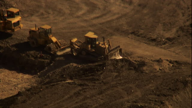 bulldozers park in an open pit. - bulldozer stock videos & royalty-free footage