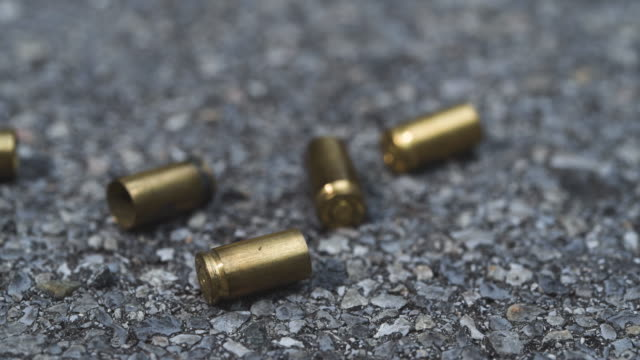 bullet casings on asphalt - weapon stock videos & royalty-free footage