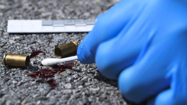 bullet casings on asphalt - cartridge stock videos & royalty-free footage