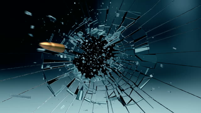 bullet exploding a glass pane - sparare video stock e b–roll
