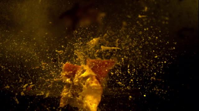 a bullet ruptures an apple. - upplösa bildbanksvideor och videomaterial från bakom kulisserna