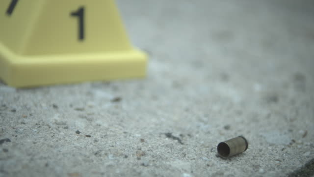 ECU, R/F, bullet shell by evidence cone on pavement, Staten Island, New York City, New York State, USA