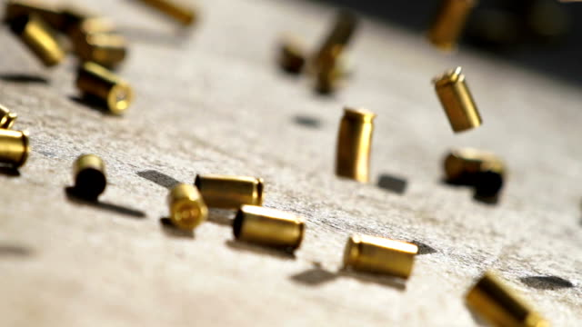 bullet shells drop - weaponry stock videos & royalty-free footage