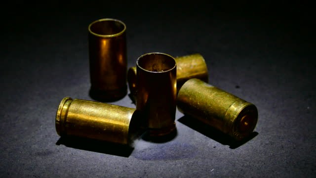 bullet shells with smoke - cartridge stock videos & royalty-free footage