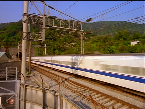 bullet train exiting tunnel + speeding past camera / japan - londonalight stock videos and b-roll footage