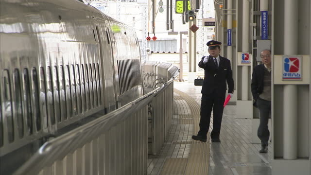 ms bullet train leaving kyoto station, japan - train guard stock videos & royalty-free footage