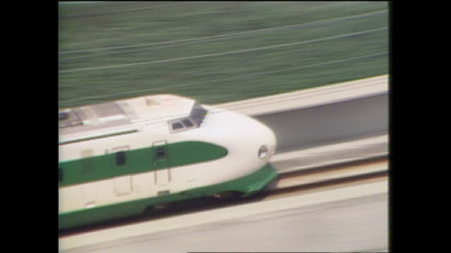 a bullet train locomotive speeds through the japanese countryside on the tohoku shinkansen line. - showa period stock videos & royalty-free footage