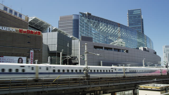 WS Bullet Train Nozomi 700 passes the Tokyo International Forum / Tokyo, Tokyo-to, Japan