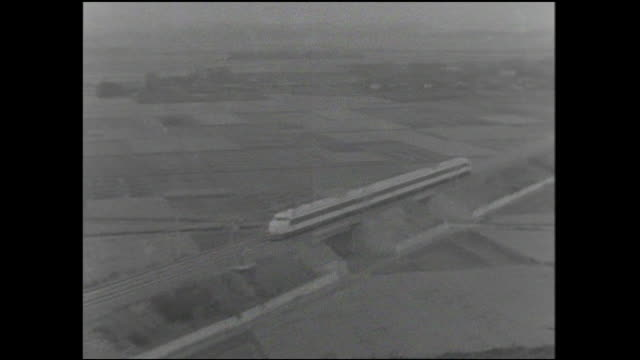 A bullet train on the Tokaido Shinkansen speeds along the tracks on a test run.