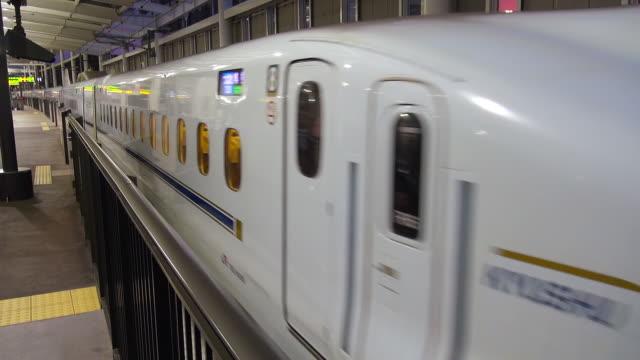 bullet train, shinkansen, in hakata station, japan - shinkansen stock videos & royalty-free footage