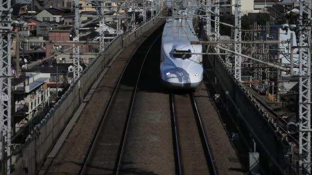 ms bullet train shinkansen passing through bridge / japan - shinkansen stock videos & royalty-free footage