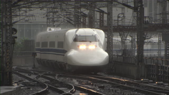 MS CU Bullet train Shinkansen slowly arriving at station / Tokyo, Tokyo Prefecture, Japan