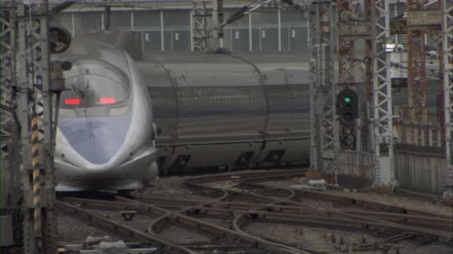 ms bullet train shinkansen slowly departing station / tokyo, tokyo prefecture, japan - shinkansen stock videos & royalty-free footage