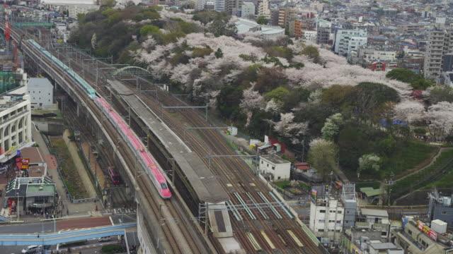 Bullet train travelling Oji Station in Tokyo, Japan