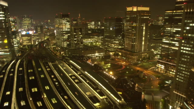 bullet trains and street traffic speed through tokyo. - 2008 stock videos & royalty-free footage
