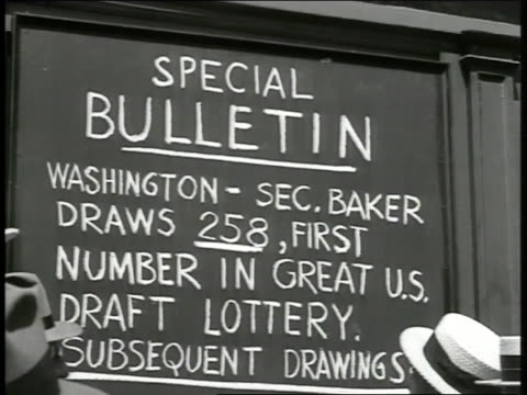 bulletin board w/ first number in draft lottery drawing posted 258 crowd standing outside looking at bulletin board man on ladder writing in lottery... - bulletin board stock videos and b-roll footage