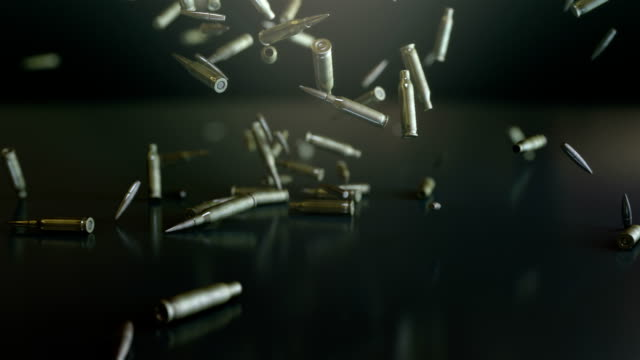 hd: bullets falling - ammunition stock videos & royalty-free footage
