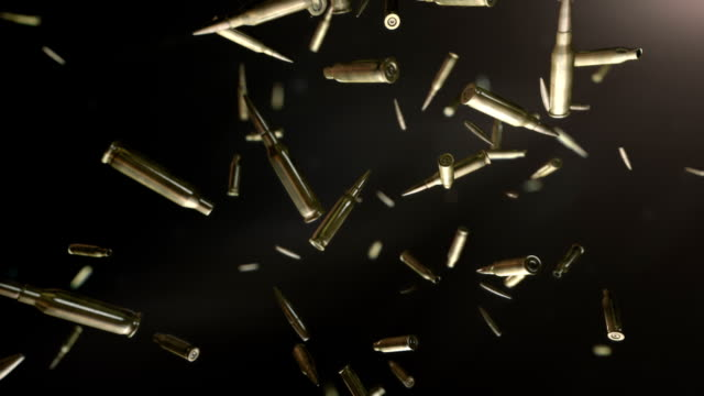 hd: bullets flight - gun stock videos & royalty-free footage