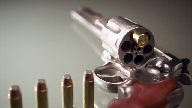 cu selective focus bullets loading 44 magnum anaconda revolver - handgun stock videos and b-roll footage