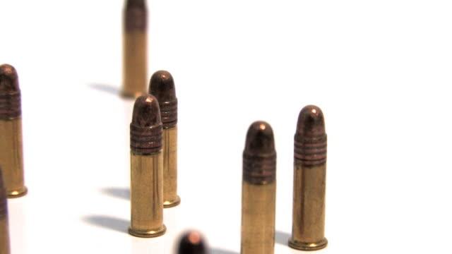 bullets rotating on white (hd loop) - bullet stock videos & royalty-free footage