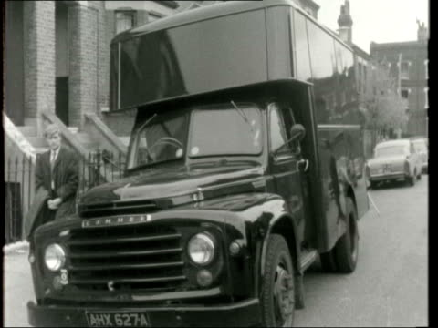 "thousand worth of bullion hijacked; england: london: kentish town: bv van with rear roller shutter: closed: fv van: pc in b/g: sign: ""twisden road... - kentish town stock videos & royalty-free footage"