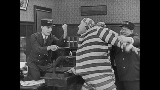 1920 Bully convict (Joe Roberts) kidnaps woman (Sybil Seely) in midst of prison riot