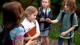 Bullying among adolescents and schoolchildren. Physical violence. A group of teenagers are pushing and insulting a schoolgirl. Adolescent violence problem
