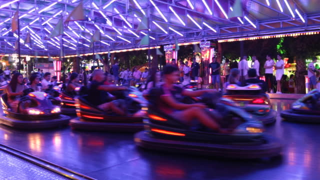 bumper cars at amusement park entertainment. bumper cars or dodgems is the generic name for a type of flat ride consisting of several small... - bumper car stock videos & royalty-free footage