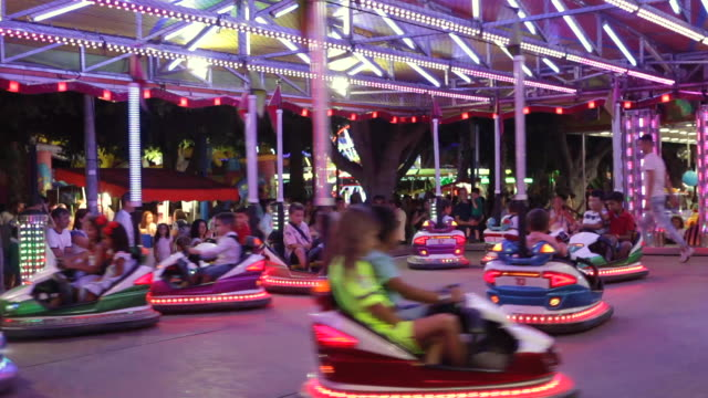 stockvideo's en b-roll-footage met bumper cars at amusement park entertainment. bumper cars or dodgems is the generic name for a type of flat ride consisting of several small... - botsauto